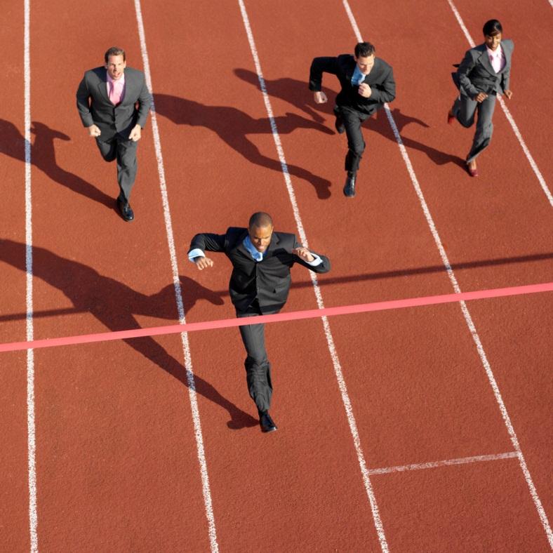 Businessmen running to finish line